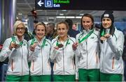 15 December 2014; Team Ireland's athletes, who won team bronze medals in the Senior Women's event, clockwise, from left, Ann Marie McGlynn, Fionnuala Britton, Michelle Finn, Siobhan O'Doherty, and Laura Crowe in Dublin Airport on their return home from the Spar European Cross Country Championships in Bulgaria. Terminal 1, Dublin Airport, Dublin. Picture credit: Brendan Moran / SPORTSFILE