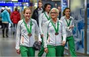 15 December 2014; Team Ireland athletes who won team bronze medals in the Senior Women's event Fionnuala Britton, left, and Ann Marie McGlynn, lead their team-mates into the Arrivals Hall in Dublin Airport on their return home from the Spar European Cross Country Championships in Bulgaria. Terminal 1, Dublin Airport, Dublin. Picture credit: Brendan Moran / SPORTSFILE