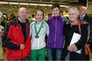 15 December 2014; Team Ireland's athlete Fionnuala Britton, who won a team bronze medal in the Senior Women's event, with her family, from left, father Eoin, sister Una and mother Ellen, in Dublin Airport on their return home from the Spar European Cross Country Championships in Bulgaria. Terminal 1, Dublin Airport, Dublin. Picture credit: Brendan Moran / SPORTSFILE