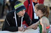 14 December 2014; Ireland's Fionnuala Britton is consoled by team physiotherapist Declan Monaghan after finishing in sixth place in the Women's race. Spar European Cross Country Championships, Samokov, Bulgaria. Picture credit: Ramsey Cardy / SPORTSFILE