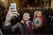 17 December 2014; WBO Middleweight Champion Andy Lee takes a selfie as he is introduced to the crowd in Limerick on his return from the USA after defeating Russian Matt Korborov. Limerick City Hall, Merchant's Quay, Limerick. Picture credit: Diarmuid Greene / SPORTSFILE