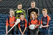 18 December 2014; The GPA Madden Leadership Programme will develop a group of county players from hurling, football and camogie with the necessary skills, motivation and experience to become successful leaders in the community. The Programme, which will run initially for three years, is a bespoke, one-year blended learning Leadership Course which will be delivered by the Gaelic Players Association in conjunction with independent leadership experts. Pictured at the launch of GPA Madden Leadership Programme are Scoil Neasáin Harmonstown pupils, from left, Ellen Potts, age 11, Niall O Cairbre, age 11, Rachel Nic Aonghusa, age 12, and Cúán O Maoileoin, age 12, with Kerry footballer Paul Murphy, left, and Mayo footballer Cillian O'Connor, right. Croke Park, Dublin. Picture credit: Ramsey Cardy / SPORTSFILE