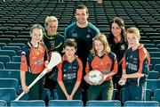 18 December 2014; The GPA Madden Leadership Programme will develop a group of county players from hurling, football and camogie with the necessary skills, motivation and experience to become successful leaders in the community. The Programme, which will run initially for three years, is a bespoke, one-year blended learning Leadership Course which will be delivered by the Gaelic Players Association in conjunction with independent leadership experts. Pictured at the launch of GPA Madden Leadership Programme are Scoil Neasáin Harmonstown pupils, from left, Ellen Potts, age 11, Niall O Cairbre, age 11, Rachel Nic Aonghusa, age 12, and Cúán O Maoileoin, age 12, with Mayo ladies football star Fiona McHale, left, Dublin footballer Ger Brennan, centre, and Wexford camogie star Ursula Jacob, right. Croke Park, Dublin. Picture credit: Ramsey Cardy / SPORTSFILE