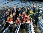 18 December 2014; The GPA Madden Leadership Programme will develop a group of county players from hurling, football and camogie with the necessary skills, motivation and experience to become successful leaders in the community. The Programme, which will run initially for three years, is a bespoke, one-year blended learning Leadership Course which will be delivered by the Gaelic Players Association in conjunction with independent leadership experts. Pictured at the launch of GPA Madden Leadership Programme are, from left, Wexford camogie star Ursula Jacob, Mayo footballer Cillian O'Connor, Dessie Farrell, Chief Executive of the Gaelic Players Association, Tipperary hurler Darren Gleeson, Armagh footballer Ciaran McKeever, Michael Madden, Limerick hurler Seamus Hickey, former Tipperary hurling manager Liam Sheedy, Kerry footballer Paul Murphy, Dublin footballer Ger Brennan and Mayo football star Fiona McHale with Scoil Neasáin Harmonstown pupils, from left, Rachel Nic Aonghusa, age 12, Niall O Cairbre, age 11, Cúán O Maoileoin, age 12, and Ellen Potts, age 11. Croke Park, Dublin. Picture credit: Ramsey Cardy / SPORTSFILE