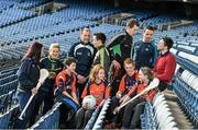 18 December 2014; The GPA Madden Leadership Programme will develop a group of county players from hurling, football and camogie with the necessary skills, motivation and experience to become successful leaders in the community. The Programme, which will run initially for three years, is a bespoke, one-year blended learning Leadership Course which will be delivered by the Gaelic Players Association in conjunction with independent leadership experts. Pictured at the launch of GPA Madden Leadership Programme are, from left, Wexford camogie star Ursula Jacob, Mayo ladies football star Fiona McHale, Armagh footballer Ciaran McKeever, Kerry footballer Paul Murphy, Mayo footballer Cillian O'Connor, Dublin footballer Ger Brennan and Limerick hurler Seamus Hickey with Scoil Neasáin Harmonstown pupils, from left, Rachel Nic Aonghusa, age 12, Niall O Cairbre, age 11, Cúán O Maoileoin, age 12, and Ellen Potts, age 11. Croke Park, Dublin. Picture credit: Ramsey Cardy / SPORTSFILE