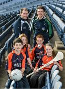 18 December 2014; The GPA Madden Leadership Programme will develop a group of county players from hurling, football and camogie with the necessary skills, motivation and experience to become successful leaders in the community. The Programme, which will run initially for three years, is a bespoke, one-year blended learning Leadership Course which will be delivered by the Gaelic Players Association in conjunction with independent leadership experts. Pictured at the launch of GPA Madden Leadership Programme are Armagh footballer Ciaran McKeever, left, and Limerick hurler Seamus Hickey with Scoil Neasáin Harmonstown pupils, from left, Niall O Cairbre, age 11,  Rachel Nic Aonghusa, age 12, Cúán O Maoileoin, age 12, and Ellen Potts, age 11. Croke Park, Dublin. Picture credit: Ramsey Cardy / SPORTSFILE