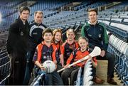 18 December 2014; The GPA Madden Leadership Programme will develop a group of county players from hurling, football and camogie with the necessary skills, motivation and experience to become successful leaders in the community. The Programme, which will run initially for three years, is a bespoke, one-year blended learning Leadership Course which will be delivered by the Gaelic Players Association in conjunction with independent leadership experts. Pictured at the launch of GPA Madden Leadership Programme are, from left, Derry dual star Chrissy McKaigue, Armagh footballer Ciaran McKeever and Limerick hurler Seamus Hickey with Scoil Neasáin Harmonstown pupils, from left, Niall O Cairbre, age 11,  Rachel Nic Aonghusa, age 12, Cúán O Maoileoin, age 12, and Ellen Potts, age 11. Croke Park, Dublin. Picture credit: Ramsey Cardy / SPORTSFILE