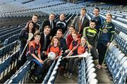 18 December 2014; The GPA Madden Leadership Programme will develop a group of county players from hurling, football and camogie with the necessary skills, motivation and experience to become successful leaders in the community. The Programme, which will run initially for three years, is a bespoke, one-year blended learning Leadership Course which will be delivered by the Gaelic Players Association in conjunction with independent leadership experts. Pictured at the launch of GPA Madden Leadership Programme are, from left, Wexford camogie star Ursula Jacob, Mayo footballer Cillian O'Connor, Dessie Farrell, Chief Executive of the Gaelic Players Association, GPA director of communications Sean Potts, Armagh footballer Ciaran McKeever, Michael Madden, Limerick hurler Seamus Hickey, Brendan Murphy, Teneo, Kerry footballer Paul Murphy, Dublin footballer Ger Brennan and Mayo football star Fiona McHale with Scoil Neasáin Harmonstown pupils, from left, Rachel Nic Aonghusa, age 12, Niall O Cairbre, age 11, Cúán O Maoileoin, age 12, and Ellen Potts, age 11. Croke Park, Dublin. Picture credit: Ramsey Cardy / SPORTSFILE