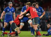 26 December 2014; Jordi Murphy, Leinster, is tackled by Tommy O'Donnell, left, and Ian Keatley, right, Munster. Guinness PRO12, Round 11, Munster v Leinster. Thomond Park, Limerick. Picture credit: Stephen McCarthy / SPORTSFILE
