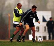 16 November 1999. Republic of Ireland Tony Cascarino shields the ball from Curtis Fleming during squad training at the Veledrom Stadium, Bursa, Turkey. Soccer. Picture credit; Brendan Moran/SPORTSFILE