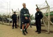 16 November 1999; Manager Mick McCarthy makes his way through security before a Republic of Ireland training session at Veledrom Stadium in Bursa, Turkey. Photo by David Maher/Sportsfile