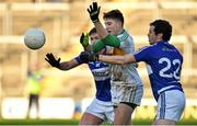 4 January 2015; Joseph O'Connor, Offaly, in action against Padraig McEvoy, left, and Padraig McMahon, Laois. Bord na Mona O'Byrne Cup, Group A, Round 1, Offaly v Laois. O'Connor Park, Tullamore, Co. Offaly. Picture credit: Barry Cregg / SPORTSFILE