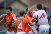 4 January 2015; Finnain Moriarty, Aaron Findon and Ciaran McKeever, Armagh, in dispute with Kyle Coney and Sean Cavanagh, Tyrone during a first half incident which saw 2 red Cards issued. Bank of Ireland Dr McKenna Cup, Group C, Round 1, Armagh v Tyrone. Athletic Grounds, Armagh. Picture credit: Oliver McVeigh / SPORTSFILE