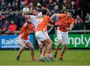 4 January 2015; Sean Cavanagh, Tyrone, in action against Eugene McVerry, Stefan Campbell and Aaron Findon, Armagh. Bank of Ireland Dr McKenna Cup, Group C, Round 1, Armagh v Tyrone. Athletic Grounds, Armagh. Picture credit: Oliver McVeigh / SPORTSFILE