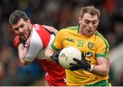 4 January 2015; Dermot Molloy, Donegal, in action against Mark Lynch, Derry. Bank of Ireland Dr McKenna Cup, Group B, Round 1, Derry v Donegal. Owenbeg Centre of Excellence, Dungiven, Co. Derry. Picture credit: Stephen McCarthy / SPORTSFILE