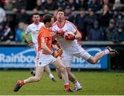 4 January 2015; Sean Cavanagh, Tyrone, in action against Finnian Moriarty, Armagh. Bank of Ireland Dr McKenna Cup, Group C, Round 1, Armagh v Tyrone. Athletic Grounds, Armagh. Picture credit: Oliver McVeigh / SPORTSFILE