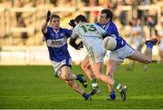 4 January 2015; Bernard Allen, Offaly, in action against Brian King, left, and Padraig McMahon, Laois. Bord na Mona O'Byrne Cup, Group A, Round 1, Offaly v Laois. O'Connor Park, Tullamore, Co. Offaly. Picture credit: Barry Cregg / SPORTSFILE