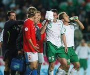 12 September 2007; Richard Dunne, Republic of Ireland, has to leave the pitch during the second half to receive medical attention. 2008 European Championship Qualifier, Czech Republic v Republic of Ireland, Sparta Prague Stadium, Prague, Czech Republic. Picture Credit: David Maher / SPORTSFILE