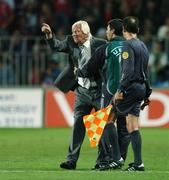 12 September 2007; Karel Bruckner, Czech Republic manager, is restrained by the fourth official, Michalis Germanakos, during the second half. 2008 European Championship Qualifier, Czech Republic v Republic of Ireland, Sparta Prague Stadium, Prague, Czech Republic. Picture Credit: David Maher / SPORTSFILE