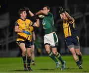 10 January 2015; Graham Reilly, Meath, in action against Colm Begley, left, and Conor Moynagh, DCU.  Bord na Mona O'Byrne Cup, Group C, Round 3, Meath v DCU. Páirc Táilteann, Navan, Co. Meath. Picture credit: Barry Cregg / SPORTSFILE