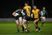 10 January 2015; Harry Rooney, Meath, in action against Eoin O'Connor, left, and Donal Smith, DCU.  Bord na Mona O'Byrne Cup, Group C, Round 3, Meath v DCU. Páirc Táilteann, Navan, Co. Meath. Picture credit: Barry Cregg / SPORTSFILE