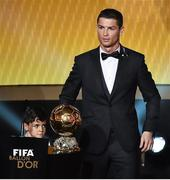 12 January 2015; Cristiano Ronaldo, Real Madrid and Portugal, with his son Cristiano Ronaldo Junior, after winning the FIFA Ballon d'Or. FIFA Ballon D'Or 2014. Kongresshaus, Zurich, Switzerland. Picture credit: David Maher / SPORTSFILE