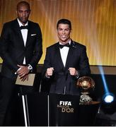 12 January 2015; Cristiano Ronaldo, Real Madrid and Portugal, celebrates after he was presented with the FIFA Ballon d'Or by former French international footballer Thierry Henry. FIFA Ballon D'Or 2014. Kongresshaus, Zurich, Switzerland. Picture credit: David Maher / SPORTSFILE