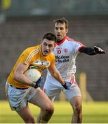 18 January 2015; Connor Burke, Antrim, in action against Mark Donnelly, Tyrone. Bank of Ireland Dr McKenna Cup, Group C, Round 3, Tyrone v Antrim, St. Tiernach's Park, Clones, Co. Tyrone. Picture credit: Oliver McVeigh / SPORTSFILE