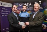 19 January 2015; Pictured in Belfield today at the announcement of Grant Thorntons patronage of the UCD GAA Football Scholarships in memory of Sean Murray, former UCD captain and Grant Thornton Partner were Kilkenny manager Brian Cody and Cork Ladies football manager Eamonn Ryan. Pictured are Noel Delaney, Grant Thornton Partner, presenting a cheque to UCD captain Jack McCaffrey and UCD GAA Executive Dave Billings. An Evening with Brian Cody and Eamonn Ryan. O'Neill Lounge, UCD, Dublin. Picture credit: David Maher / SPORTSFILE