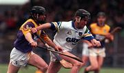 27 February 2000; Dave Bennett of Waterford in action against Sean Flood of Wexford during the Church & General National Hurling League Division 1B Round 2 match between Waterford and Wexford at Walsh Park in Waterford. Photo by Matt Browne/Sportsfile