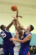 4 December 1999; Kareem Lewis of BK Limerick in action against Ferdinand Williams, left, and Brian Tonkovich of St Vincent's during the ESB Men's Superleague Basketball match between St Vincent's and BK Limerick at St Vincent's Basketball Club in Glasnevin, Dublin. Photo by Brendan Moran/Sportsfile
