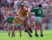 4 August 1996; Gary O'Kane of Antrim in action against Ger Hegarty of Limerick during the Guinness All-Ireland Senior Hurling Championship Semi-Final match between Antrim and Limerick at Croke Park in Dublin. Photo by Ray McManus/Sportsfile