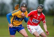 24 January 2015; Patrick Donnellan, Clare, in action against Brian O'Sullivan, Cork. Waterford Crystal Cup, Semi-Final, Cork v Clare, Mallow, Co. Cork. Picture credit: Diarmuid Greene / SPORTSFILE