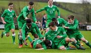 25 January 2015; Glen McAuley, 7, Republic of Ireland, is congratulated by team-mates after scoring his side's first goal with teammates, from left, Sultan Owolabi, Dominic Peppard and Alan McColgan. U15 Soccer International, Republic of Ireland v Scotland, Tanavalla, Listowel, Co. Kerry. Picture credit: Brendan Moran / SPORTSFILE