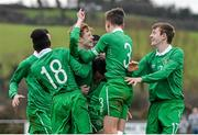 25 January 2015; Glen McAuley, 2nd from left, Republic of Ireland, is congratulated by team-mates Sultan Owolabi, 18, Lee O'Connor, 3, and Cian Hughes, right, after scoring their side's only goal. U15 Soccer International, Republic of Ireland v Scotland, Tanavalla, Listowel, Co. Kerry. Picture credit: Brendan Moran / SPORTSFILE