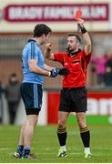 25 January 2015; Referee David Gough shows Dublin's Michael Darragh Macauley the red card in the closing minutes of normal time. Bord na Mona O'Byrne Cup Final, Kildare v Dublin, St Conleth's Park, Newbridge, Co. Kildare. Picture credit: Piaras Ó Mídheach / SPORTSFILE
