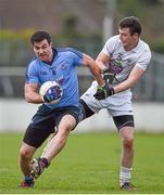 25 January 2015; Michael Darragh Mcauley, Dublin, is tackled by Kildare's Fionn Dowling. Bord na Mona O'Byrne Cup Final, Kildare v Dublin, St Conleth's Park, Newbridge, Co. Kildare. Picture credit: Ray McManus / SPORTSFILE