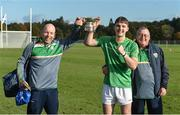 21 October 2017; Patrick Curran of Ireland with kitmen Tommy Byrne, left, and Roger Casey and the cup after the U21 Shinty International match between Ireland and Scotland at Bught Park in Inverness, Scotland. Photo by Piaras Ó Mídheach/Sportsfile