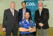 31 January 2015: James McCarthy, Limerick, receives his Hurler of the Year award from Paul Harte, left, Chairman of St. Peregrines GAA Club; Leo Varadkar, TD, Minister for Health; and Martin Donnelly, M. Donnelly. GAA Wheelchair Hurling Blitz/All-Star Awards, St. Peregrines GAA Club, Blakestown Road, Dublin.  Picture credit: Barry Cregg / SPORTSFILE
