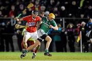 31 January 2015: Adrian Breen, Limerick, in action against Brian O'Sullivan, Cork. Waterford Crystal Cup Final, Cork v Limerick. Mallow GAA Grounds, Mallow, Co. Cork Picture credit: Ramsey Cardy / SPORTSFILE