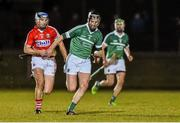31 January 2015: Donal O'Grady, Limerick, in action against Cian McCarthy, Cork. Waterford Crystal Cup Final, Cork v Limerick. Mallow GAA Grounds, Mallow, Co. Cork Picture credit: Ramsey Cardy / SPORTSFILE