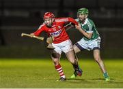 31 January 2015: Stephen Moylan, Cork, is tackled by Tom Condon, Limerick. Waterford Crystal Cup Final, Cork v Limerick. Mallow GAA Grounds, Mallow, Co. Cork Picture credit: Ramsey Cardy / SPORTSFILE