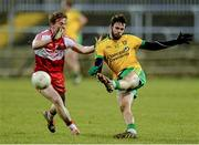 31 January 2015: Odhrán Mac Niallais, Donegal, in action against Liam McGoldrick, Derry. Allianz Football League Division 1, Round 1, Donegal v Derry. MacCumhail Park, Ballybofey, Co. Donegal Picture credit: Oliver McVeigh / SPORTSFILE
