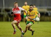 31 January 2015: Mark McHugh, Donegal, in action against Enda Lynn, Derry. Allianz Football League Division 1, Round 1, Donegal v Derry. MacCumhail Park, Ballybofey, Co. Donegal Picture credit: Oliver McVeigh / SPORTSFILE