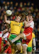 31 January 2015: Michael Murphy, Donegal, contests a high ball with Mark Lynch, Derry. Allianz Football League Division 1, Round 1, Donegal v Derry. MacCumhail Park, Ballybofey, Co. Donegal Picture credit: Oliver McVeigh / SPORTSFILE