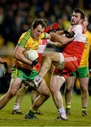 31 January 2015: Michael Murphy, Donegal, in action against Mark Lynch, Derry. Allianz Football League Division 1, Round 1, Donegal v Derry. MacCumhail Park, Ballybofey, Co. Donegal Picture credit: Oliver McVeigh / SPORTSFILE