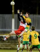 31 January 2015: Martin McElhinney, Donegal, in action against Liam McGoldrick, Derry. Allianz Football League Division 1, Round 1, Donegal v Derry. MacCumhail Park, Ballybofey, Co. Donegal Picture credit: Oliver McVeigh / SPORTSFILE