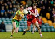 31 January 2015: Daniel McLaughlin, Donegal, in action against Liam McGoldrick, Derry. Allianz Football League Division 1, Round 1, Donegal v Derry. MacCumhail Park, Ballybofey, Co. Donegal Picture credit: Oliver McVeigh / SPORTSFILE