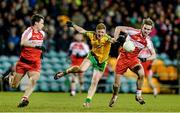 31 January 2015: Daniel McLaughlin, Donegal, in action against Kevin Johnston and Liam McGoldrick, Derry. Allianz Football League Division 1, Round 1, Donegal v Derry. MacCumhail Park, Ballybofey, Co. Donegal Picture credit: Oliver McVeigh / SPORTSFILE