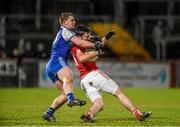 31 January 2015: Shea McGuigan, Tyrone, in action against Dermot Malone, Monaghan. Allianz Football League Division 1, Round 1, Tyrone v Monaghan. Healy Park, Omagh, Co. Tyrone Picture credit: Paul Mohan / SPORTSFILE
